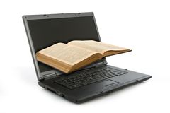 Laptop and old book Stock Photography