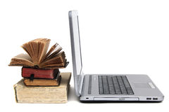 Laptop and old books Stock Photos