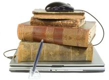 Laptop and old books with path. On white Royalty Free Stock Images