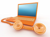 Laptop with old-fashioned phone reciever Royalty Free Stock Photo