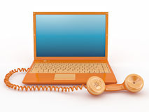 Laptop with old-fashioned phone reciever Stock Image