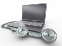Laptop with old-fashioned phone reciever Royalty Free Stock Image