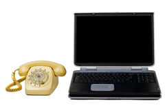 Laptop and old phone. Royalty Free Stock Photography
