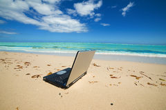 Laptop On The Beach Royalty Free Stock Images