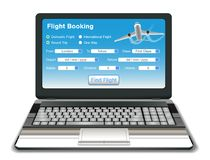 Laptop with online flight booking interface Royalty Free Stock Images