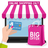 Laptop Online Shopping with Pink Bag Stock Photography