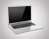 Laptop op een grijze achtergrond wordt geïsoleerd die Royalty-vrije Stock Foto's