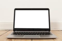 Laptop op Houten Vloer Stock Foto