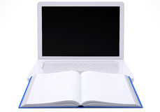 Laptop with open book Stock Photo
