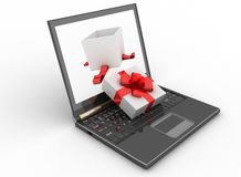 Laptop and open box of gift Stock Image