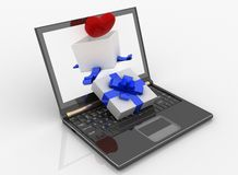 Laptop and open box for gift with a heart Stock Images