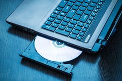Laptop with open CD - DVD drive Stock Photo