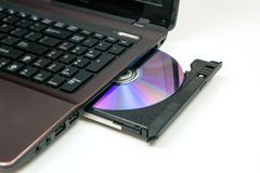 Laptop with open CD or DVD-ROM Stock Images