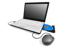 Laptop with open compact disc tray and mouse Royalty Free Stock Photo