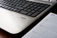 Laptop with opened planner Stock Photos
