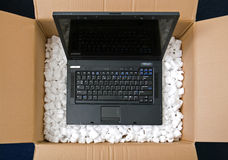 Laptop in opening package box Royalty Free Stock Image