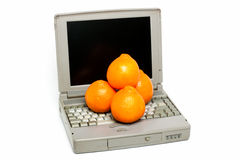 Laptop with oranges Royalty Free Stock Photos