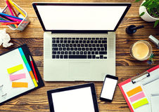 Laptop with other modern electonic devices on desk Royalty Free Stock Images