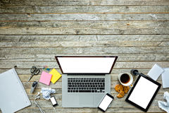 Laptop with other modern electonic devices on desk Royalty Free Stock Photo