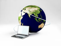 Laptop and our Earth, internet Royalty Free Stock Photography