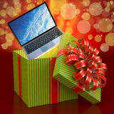 Laptop out of a gift box Royalty Free Stock Photos