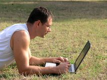 With laptop outdoor Royalty Free Stock Image
