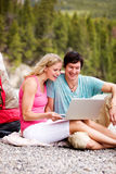 Laptop Outdoor Couple Camping Stock Photo