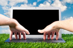 Laptop outdoors Stock Photography