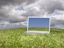 Laptop outdoors on a green field Royalty Free Stock Photos