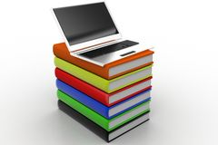Laptop over books Stock Photos