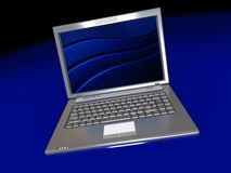 Laptop over dark background Royalty Free Stock Photos