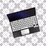 Laptop over flowerish texture Stock Image