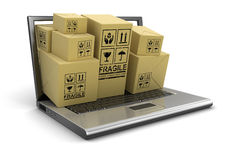 Laptop and packages (clipping path included) Royalty Free Stock Photography