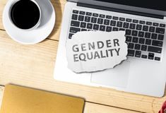 Laptop and paper with gender equality text on wooden table. Equality gender concept stock photos