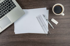 Laptop, paper pen Ruler and Eraser with cup of coffee Royalty Free Stock Image