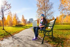 With laptop in the park Stock Photography
