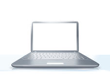 Laptop PC on glass table isolated Royalty Free Stock Images