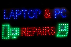 Laptop and Pc repairs neon sign. At night Stock Photos