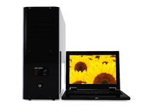 Laptop and pc tower Royalty Free Stock Photography