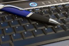 Laptop and Pen Stock Image