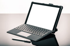Laptop with pen on black surface Royalty Free Stock Image