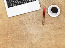 Laptop, pen and coffee on a desk Royalty Free Stock Images