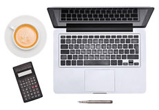 Laptop. pen, cup and calculator Royalty Free Stock Photography