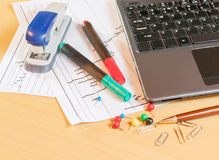 Laptop, pen and office supplies Royalty Free Stock Photo