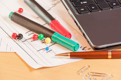Laptop, pen and office supplies on office desk Royalty Free Stock Image