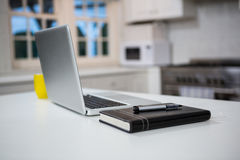 Laptop with personal organizer and pen on the table Stock Photo