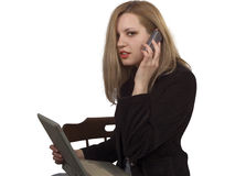 Laptop and phone communication Stock Image