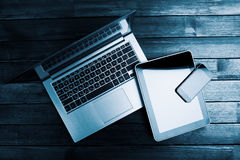Laptop with phone and tablet pc Royalty Free Stock Photos