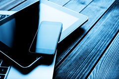 Laptop with phone and tablet pc Stock Photo