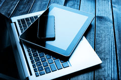 Laptop with phone and tablet pc Royalty Free Stock Photo